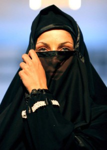 An Iranian model presents the latest Islamic fashion for women at a fashion show