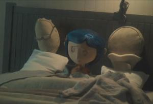 Coraline and pillow parents in bed